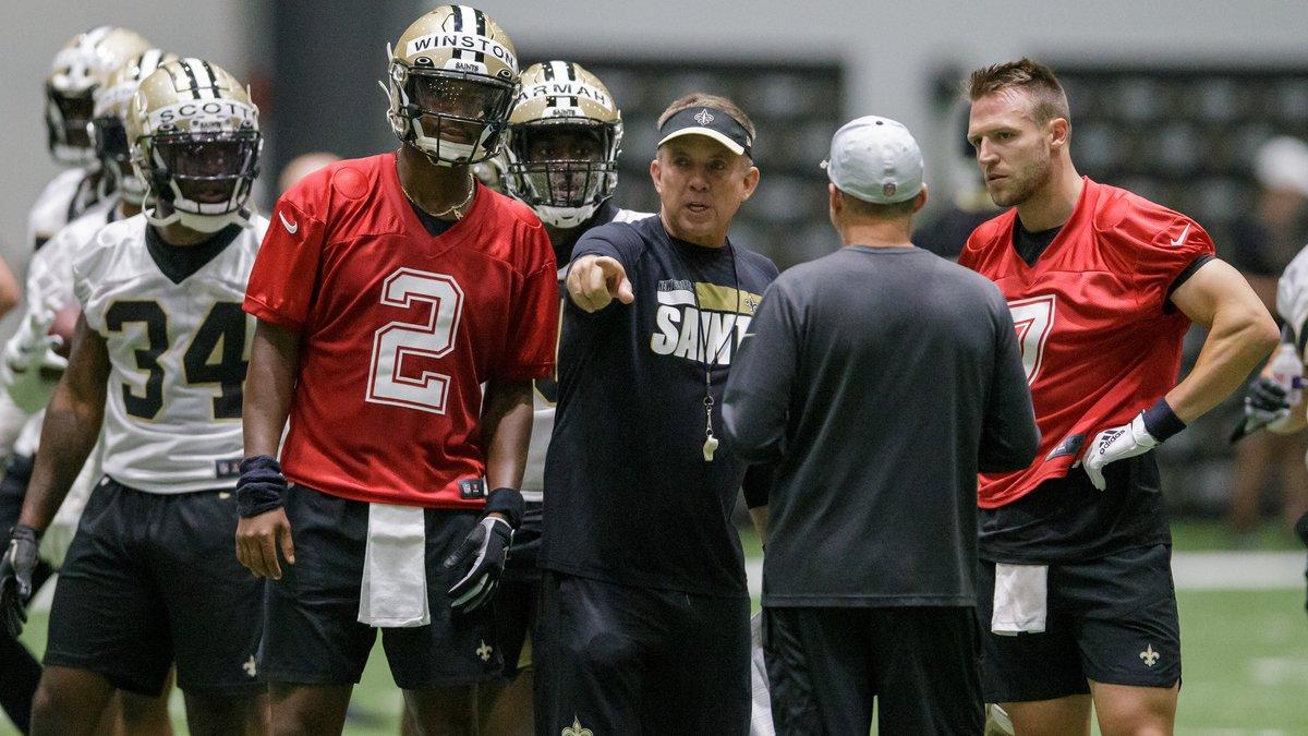 New Orleans Saints head coach Sean Payton, center, gives instruction to New Orleans Saints...