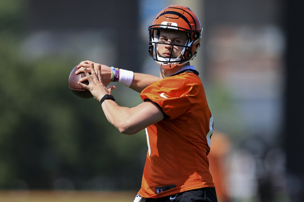 Cincinnati Bengals Joe Burrow throws a pass during an NFL football camp practice in Cincinnati,...