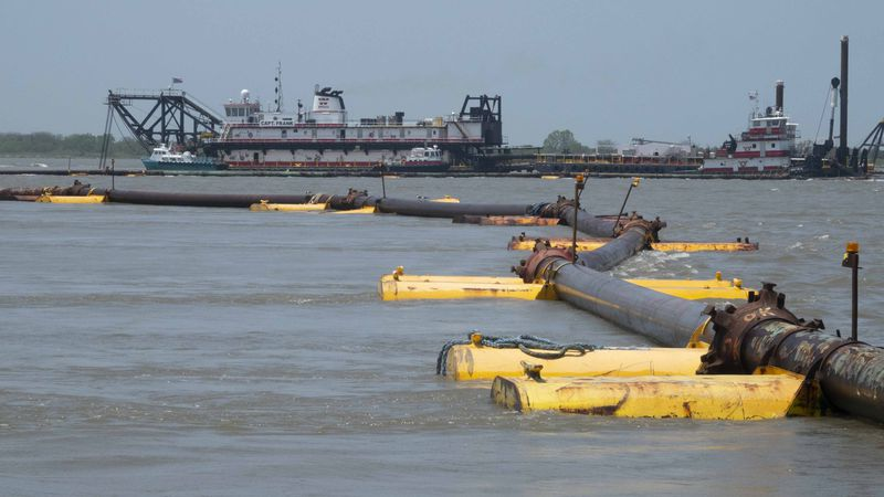 Pipe runs from a dredge ship in the Birdsfoot Delta of Louisiana near Head of Passes on the...