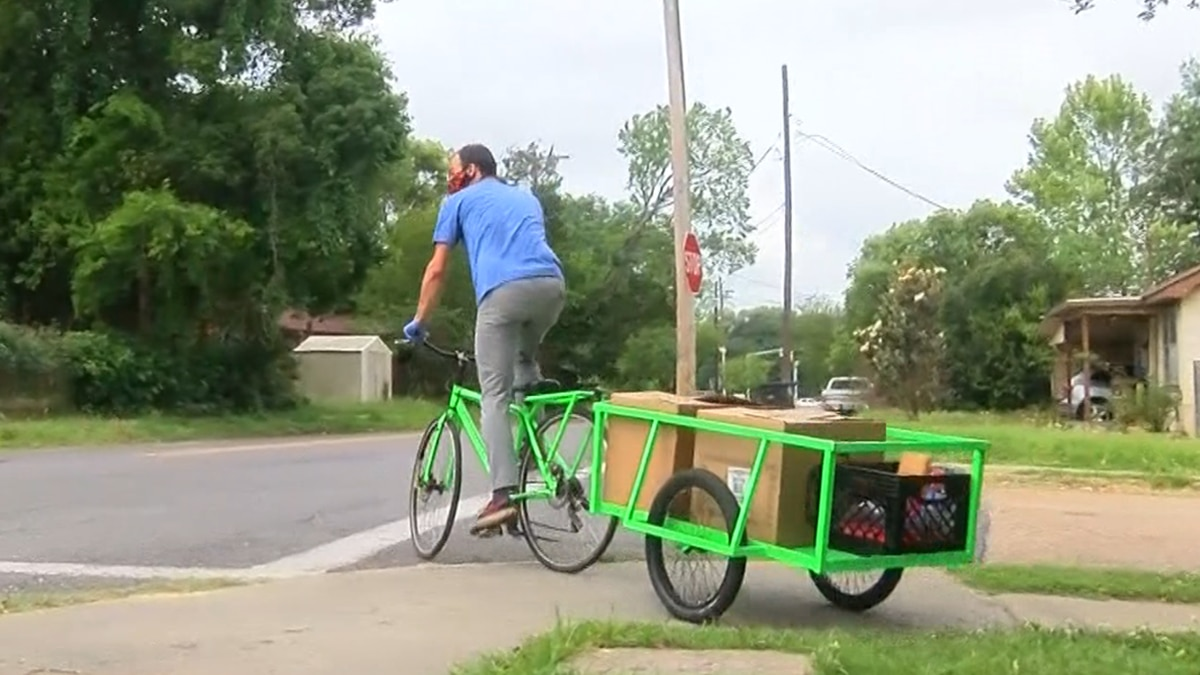 Kincaid Nelson with Front Yard Bikes helps deliver meals to needy families.
