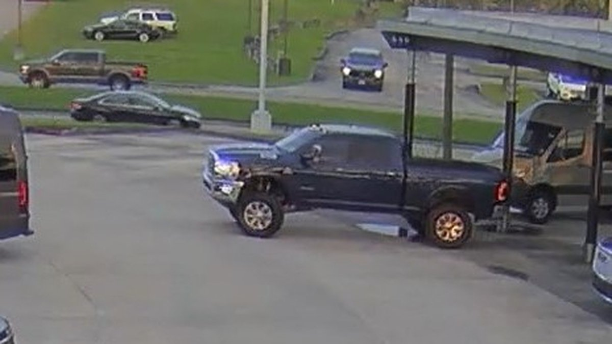 Deputies say surveillance video shows woman allegedly stealing truck from dealership.