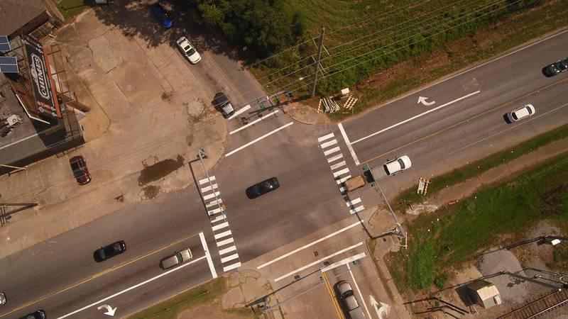 Aerial photo of the pedestrian crosswalks at Nicholson Dr and Bob Pettit Blvd. LSU student...