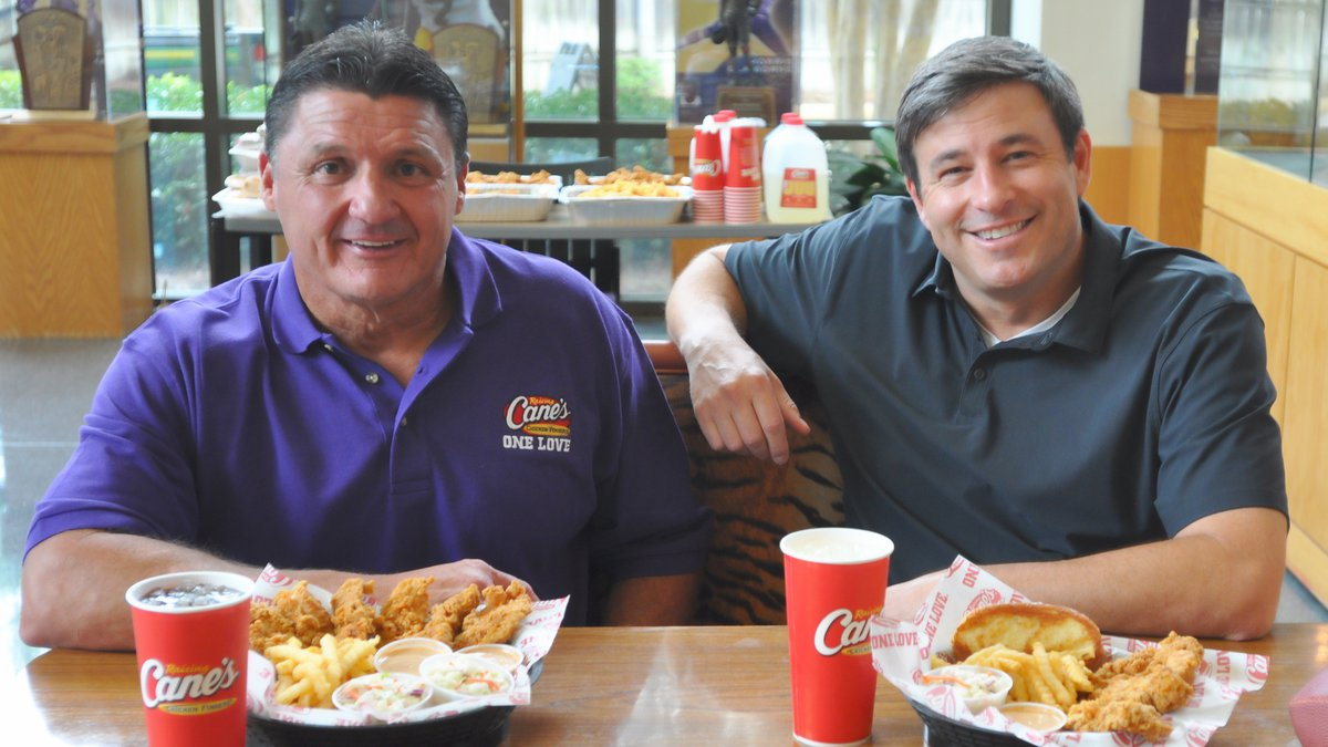LSU head football coach Ed Orgeron (right) and Raising Cane's Chicken Fingers founder and CEO...