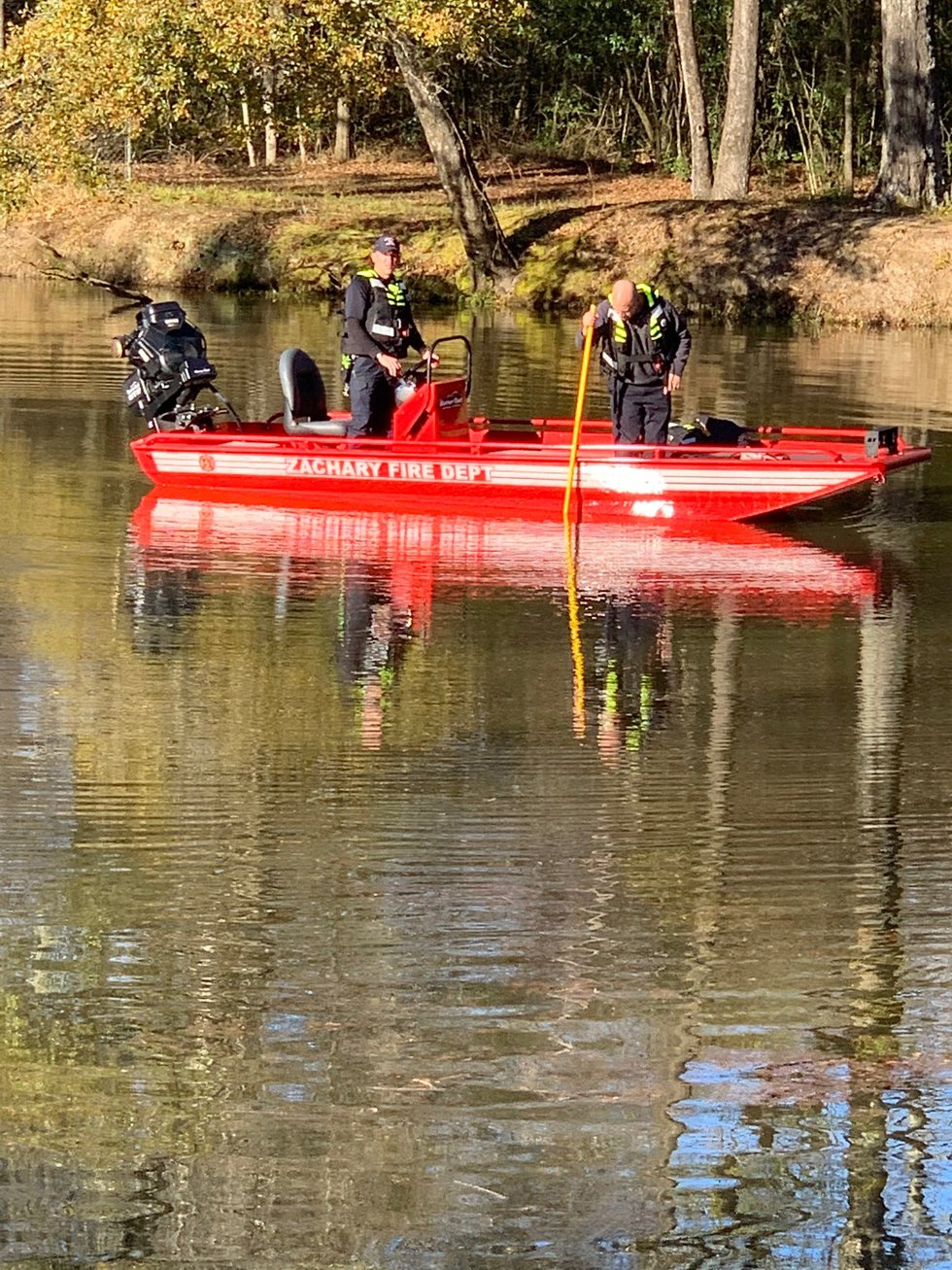 One body was recovered from a vehicle that was submerged in a pond in Zachary.
