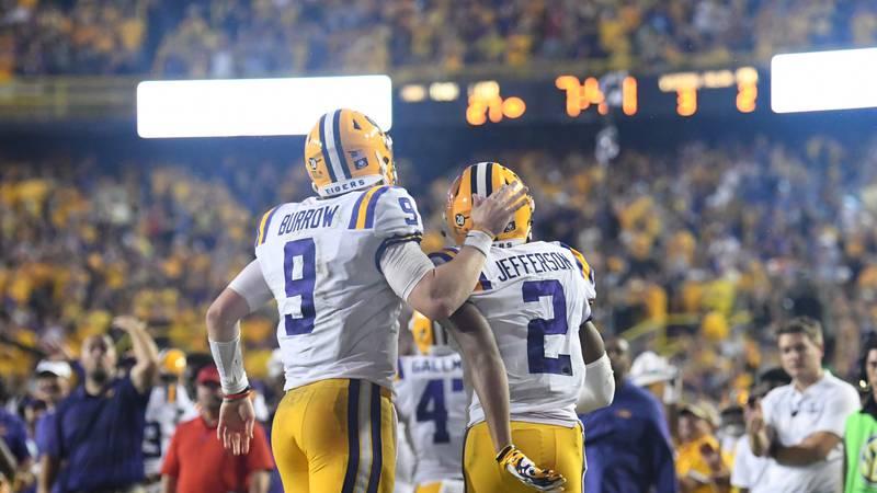 LSU quarterback Joe Burrow celebrates with wide receiver Justin Jefferson after a 65-yard...