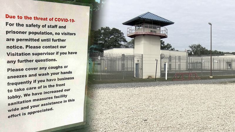A sign posted at the St. Tammany Parish Jail about precautions in place due to COVID-19. The...